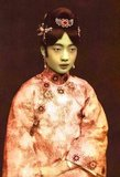 Gobulo Wan Rong ('Beautiful Countenance') was the daughter of Rong Yuan, the Minister of Domestic Affairs of the Qing Government and head of one of Manchuria's most prominent, richest families. At the age of 17, Wan Rong was selected from a series of photographs presented to the Xuan Tong Emperor (Puyi). The wedding took place when Puyi reached the age of 16. Wan Rong was the last Empress Consort of the Qing Dynasty in China, and later Empress of Manchukuo (also known as the Manchurian Empire). Empress Wan Rong died of malnutrition and opium addiction in prison in Jilin. She was portrayed memorably if somewhat inaccurately by Joan Chen in the 1987 picture 'The Last Emperor'.