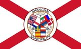 The flag of Shanghai International Settlement. The flags are: Top left: Great Britain, United States, France, Germany. Top right: Russia, Denmark, Italy, Portugal. Bottom: Norway and Sweden (upside down), Austria, Spain, Netherlands. The Latin reads: Juncta In Uno Omnia (All Joined in One), while the Chinese reads: Gong Bu Ju (Municipal Council).