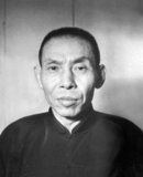 Du Yuesheng (Tu Yüeh-sheng), commonly known as 'Big-Ears Du' (1887–1951) was a Chinese gangster who spent much of his life in Shanghai. He was a key supporter of the Kuomintang (KMT; aka Nationalists) and Chiang Kai-shek in their battle against the Communists during the 1920s, and was a figure of some importance during the Second Sino-Japanese War. After the Chinese Civil War and the KMT's retreat to Taiwan, Du went into exile in Hong Kong and remained there until his death in 1951.