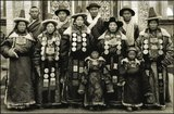 Lanzhou, the capital of Gansu, is close to both Inner Mongiolia and to Autonomous Tibetan Regions of Qinghai and Gansu Provinces. The family in this image were clearly well-to-do and are dressed in their richest and most lavish clothing.